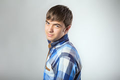 Portrait of casual young man turning toward camera Stock Photos