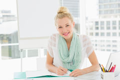 Portrait of a casual young woman with catalog Stock Image