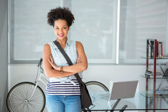 Portrait of casual young woman standing with arms crossed Stock Photos