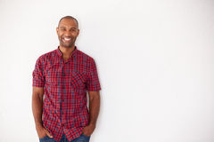 Portrait Of Casually Dressed Man Leaning Against White Wall Royalty Free Stock Photos