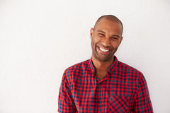 Portrait Of Casually Dressed Man Leaning Against White Wall Royalty Free Stock Image