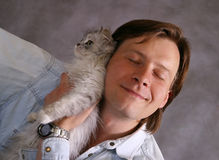 Portrait with a cat stock photography