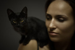 Portrait with cat Stock Images