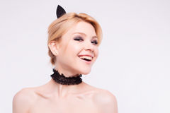 Portrait of cat girl with makeup in studio.  Royalty Free Stock Photo
