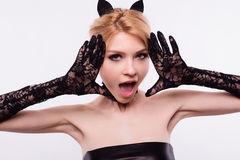 Portrait of cat girl with makeup in studio.  Royalty Free Stock Image
