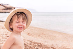 Portrait of caucasian baby at the beach. Royalty Free Stock Photos
