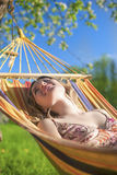 Portrait of Caucasian Blond Lady Resting in Hummock During Spring Time. Outdoors.Vertical Image Composition Stock Image