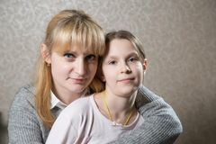 Portrait of caucasian blonde woman with her beautifull daughter. Stock Photo