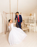 Portrait of Caucasian bride and Asian groom indoors.  Royalty Free Stock Photography