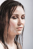 Portrait of Caucasian Brunette Girl with Closed Eyes Showing Wet and Shining Skin and Wet Hair. Stock Images