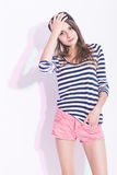 Portrait of Caucasian Brunette Girl in Hat and Striped Shirt. Stock Image