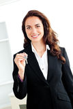 Portrait of a caucasian businesswoman holding key Royalty Free Stock Photography