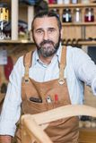 Portrait of caucasian carpenter at work Royalty Free Stock Image