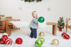 Caucasian child baby celebrating Christmas or New Year royalty free stock image