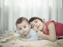Portrait of caucasian children playing at home Stock Photo