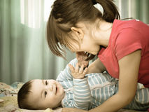 Portrait of caucasian children playing at home Royalty Free Stock Images