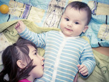 Portrait of caucasian children playing at home Royalty Free Stock Photography