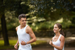 Portrait of  Caucasian couple running outdoors Stock Photography