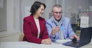 Portrait of caucasian elderly married couple shopping online stock video