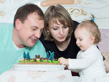 Portrait of caucasian family on happy birthday with cake royalty free stock photography