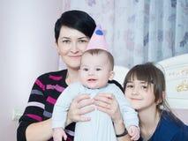 Portrait of caucasian family on happy birthday. Caucasian family on happy birthday at home stock image