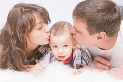 Portrait of Caucasian family with little son together on floor k Royalty Free Stock Photography