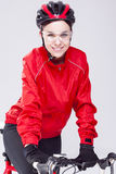 Portrait of Caucasian Female Cyclist Equipped in Cycling Outfit and Posing With Road Bike Stock Image