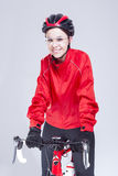 Portrait of Caucasian Female Cyclist Equipped in Cycling Outfit and Posing With Road Bike Stock Photo