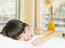 Portrait of caucasian funny girl child kid on the bed home royalty free stock image