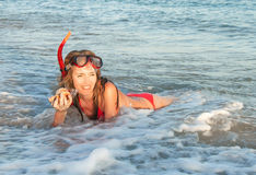 Portrait of caucasian girl at the beach with snorkeling mask. Stock Photo
