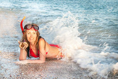 Portrait of caucasian girl at the beach with snorkeling mask and Royalty Free Stock Image