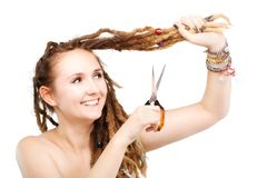 Girl cutting her dreadlocks. Portrait of a caucasian girl with scissors about to cut her dreadlocks Stock Image