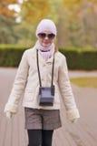 Portrait of caucasian girl walking in park Stock Photo