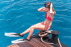 Portrait of caucasian girl at the yacht  with snorkeling mask an Royalty Free Stock Images