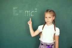 Portrait of caucasian happy child girl. School chalkboard or blackboard background. Education and school concept. Portrait of caucasian happy child girl. School Royalty Free Stock Photography