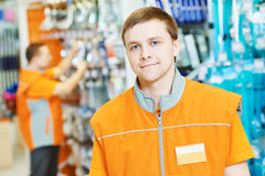 Portrait of caucasian hardware store salesman. Portrait of young male caucasian salesman or salesperson in hardware store Stock Images