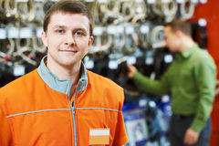 Portrait of caucasian hardware store salesman. Portrait of young male caucasian salesman or salesperson in hardware store Royalty Free Stock Photos