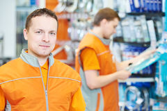 Portrait of caucasian hardware store salesman. Portrait of young male caucasian salesman or salesperson in hardware store Stock Photography