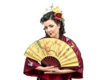 Portrait of Caucasian kimono mature woman with fan Royalty Free Stock Photos