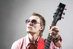Portrait of Caucasian Male Guitarist Playing the Guitar and Look Stock Photo