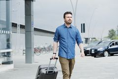 Portrait of caucasian male in railway train station royalty free stock photography
