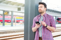 Portrait of caucasian male in railway train station royalty free stock photos