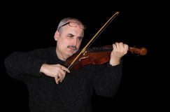Portrait of a Caucasian man playing the violin Royalty Free Stock Photo