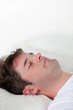 Portrait of a caucasian man sleeping on his bed Royalty Free Stock Images