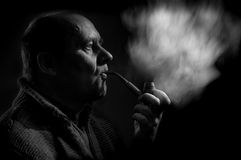 Portrait of a caucasian man smoking tobacco pipe Stock Image