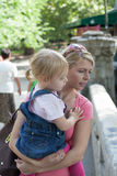 Portrait caucasian mother and daughter looking down on the bridge Royalty Free Stock Photos