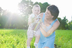 Portrait of Caucasian Mother with Her Little  Son Spending Time Together Outdoors in Park Royalty Free Stock Images
