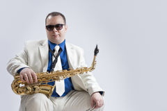 Portrait of Caucasian Saxophone Player Posing with Instrument Stock Photo