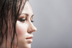 Portrait of Caucasian Sensual Brunette Girl Showing Wet and Shining Skin and Wet Hair Stock Photos