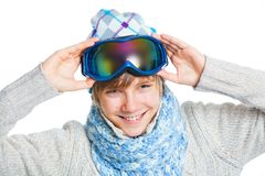 Portrait of a caucasian teenager in ski wearing. Clouse up portrait of a caucasian cute teenager in ski goggles and a scarf, isolated on white Royalty Free Stock Photography